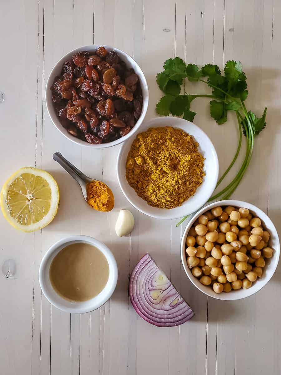 Spices, Chickpeas, Onions, Cilantro, Lemon, Raisns, And Tahini