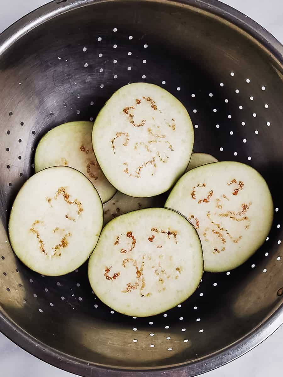 Sliced Raw Eggplant In A Strainer