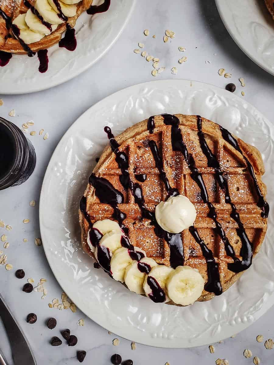Waffles With Blueberry Syrup Drizzle And Bananas