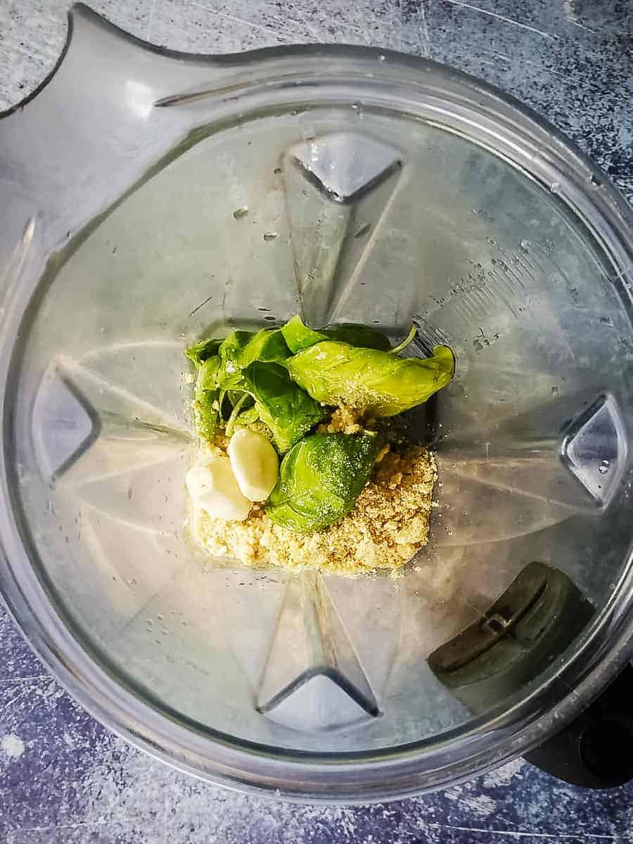 Basil, Cashew Parmesan, Garlic, and Oil in a Blender