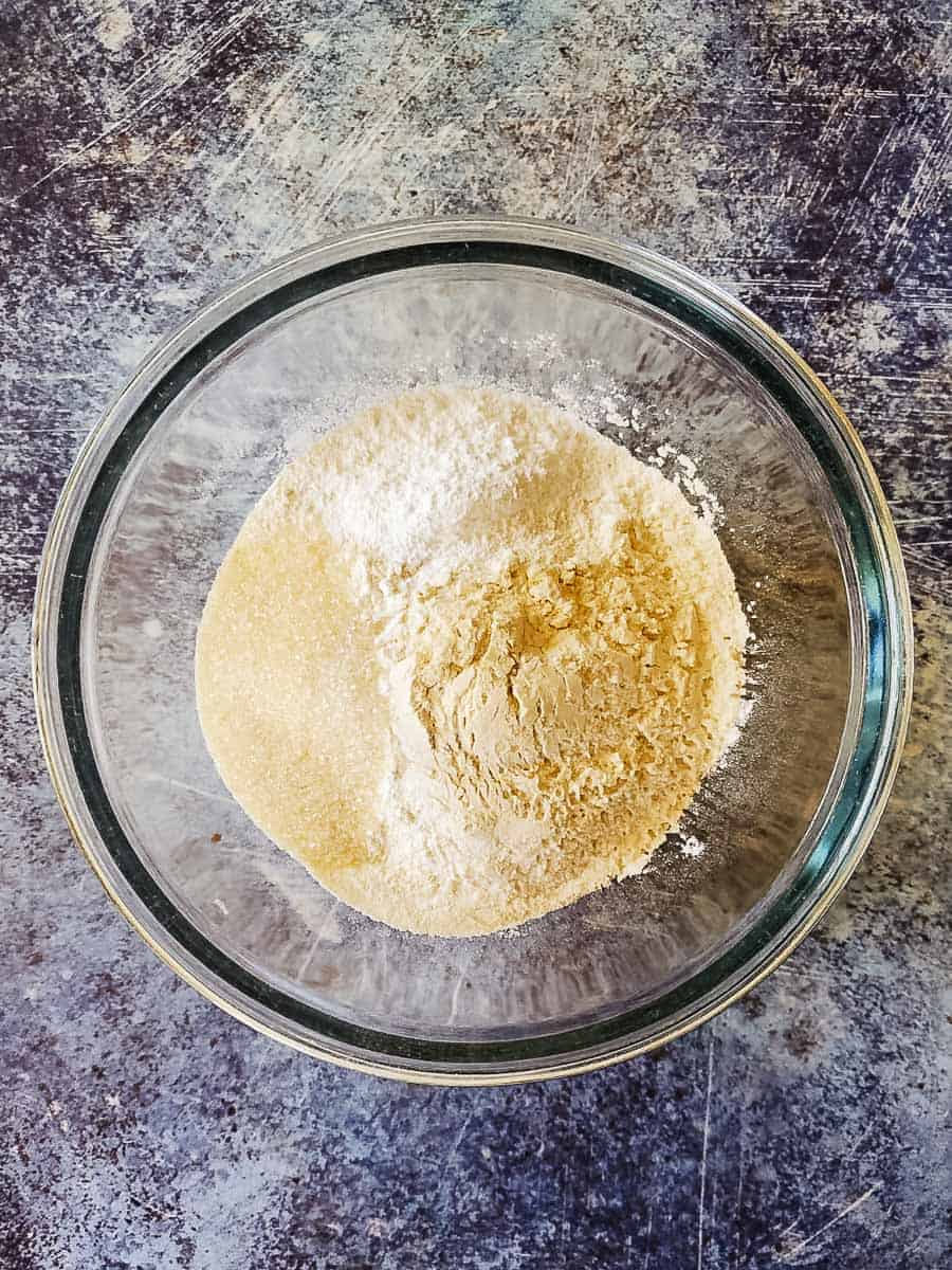 Flour, Sugar, Baking Powder, And Salt In A Bowl