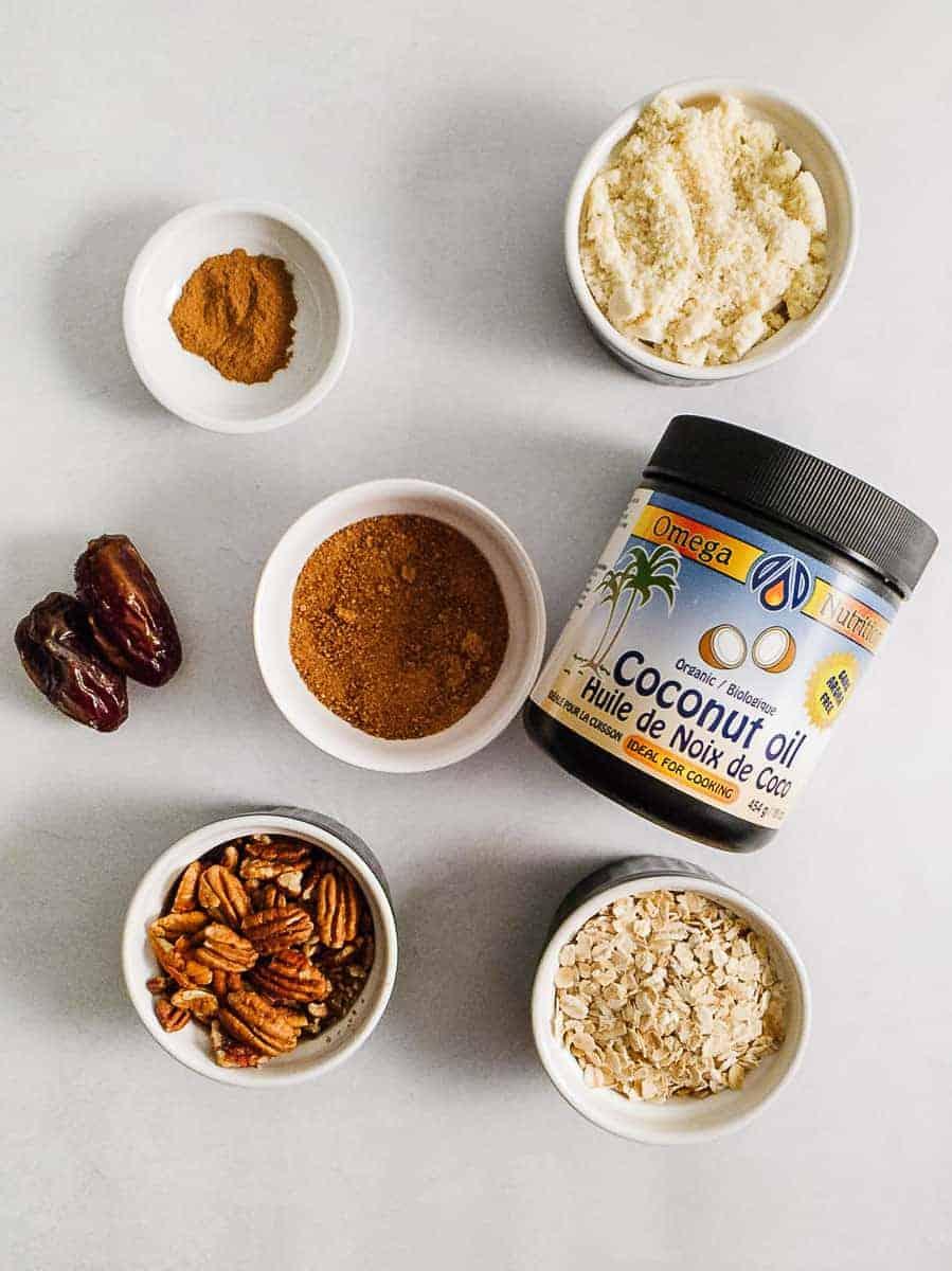 Coconut Oil, Almond Flour, Dates, Sugar, Spices, Nuts, & Oats