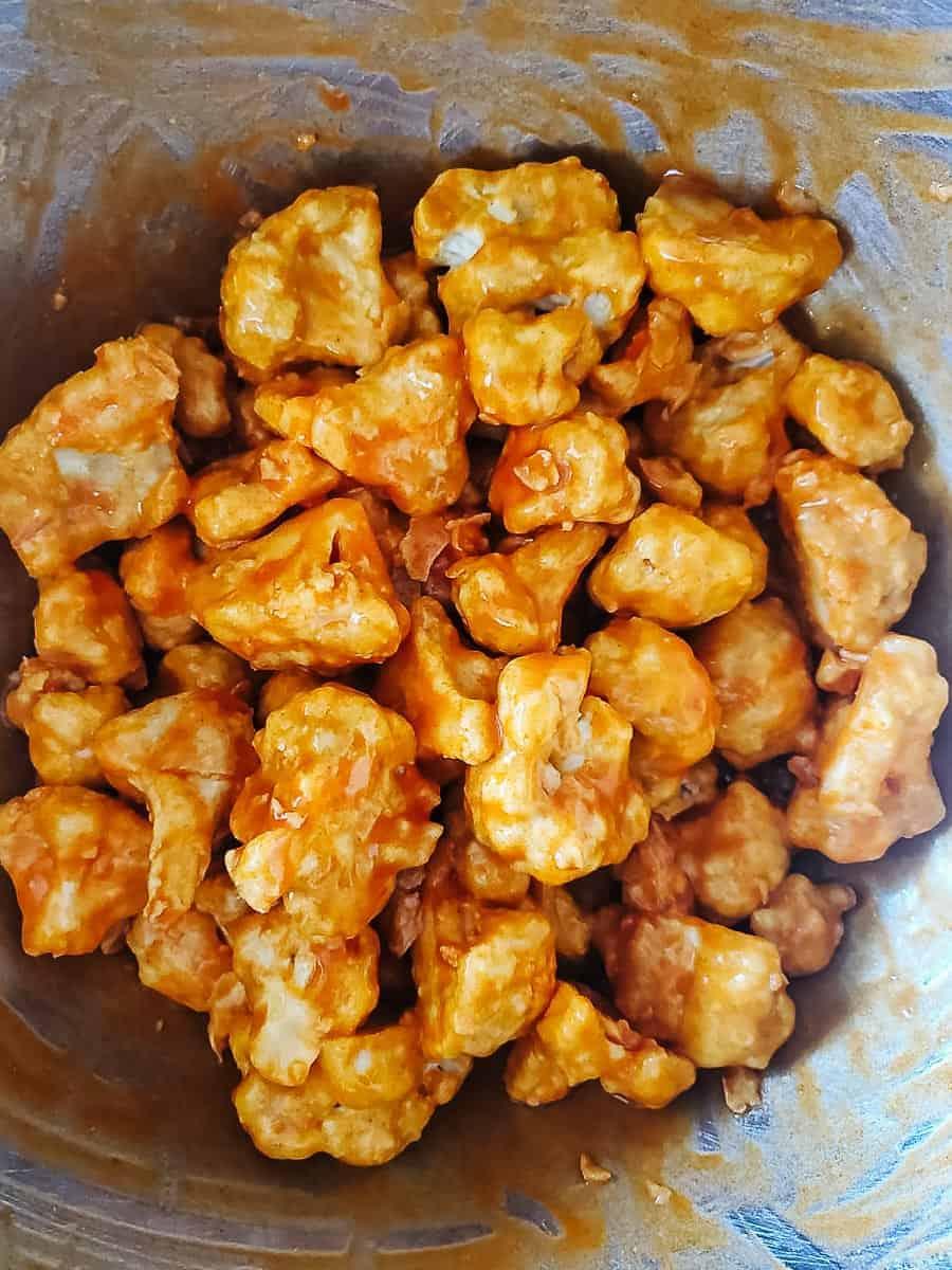 Breaded Cauliflower Wings Tossed In Buffalo Sauce
