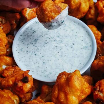 Buffalo Cauliflower Wings Dipped In Homemade Vegan Ranch