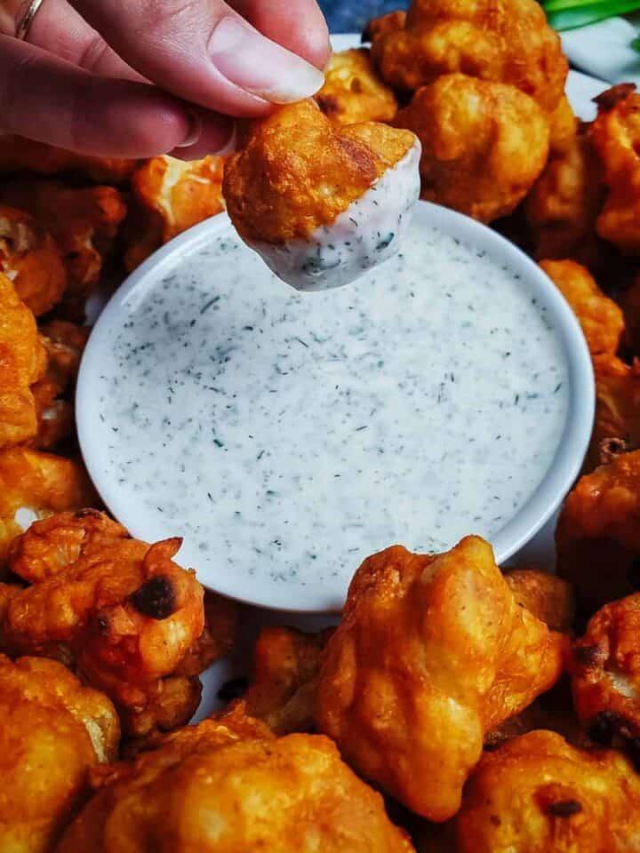 Buffalo Cauliflower Wings Dipped In Homemade Vegan Ranch