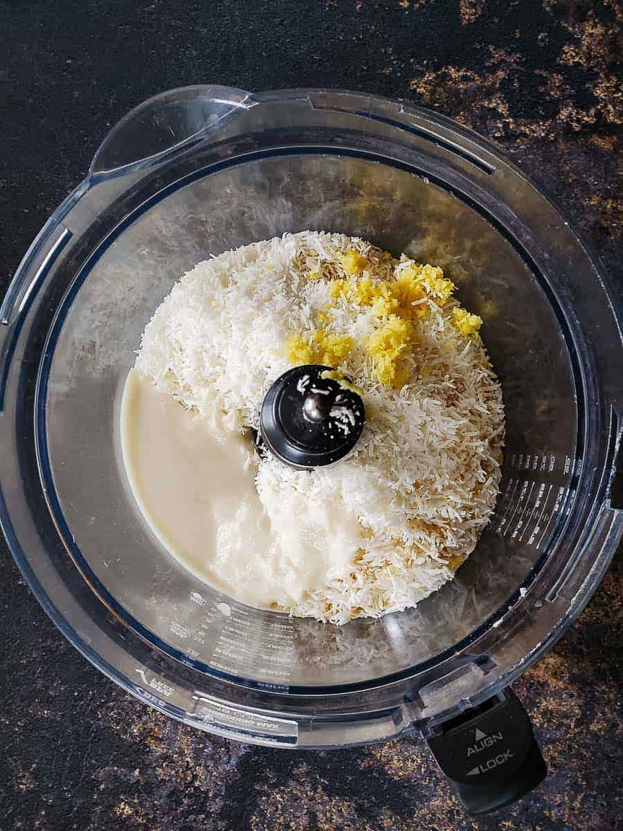 Coconut Shreds, Coconut Manna, Lemon Zest, And Cashews In A Food Processor