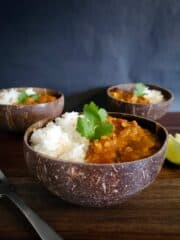 Three Bowls Of Red Lentil Dahl And Rice