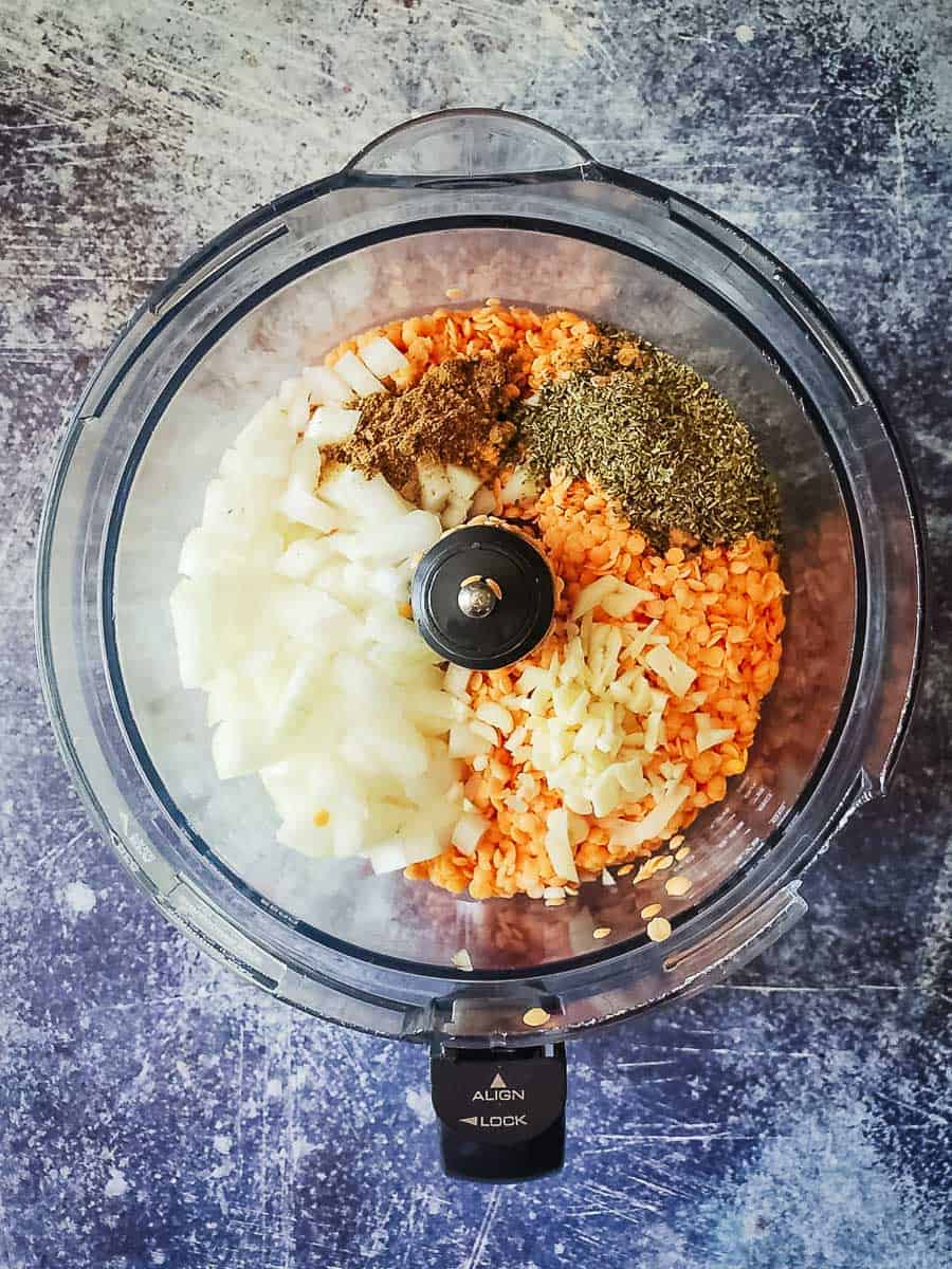 Lentils, Spices, Onions, and Oil In A Food Processor