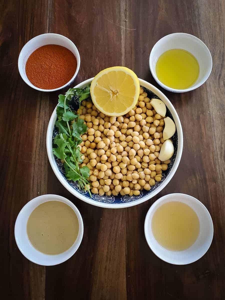 Chickpeas, Lemon, Cilantro, Tahini, Garlic, Oil, Aquafaba, And Spices