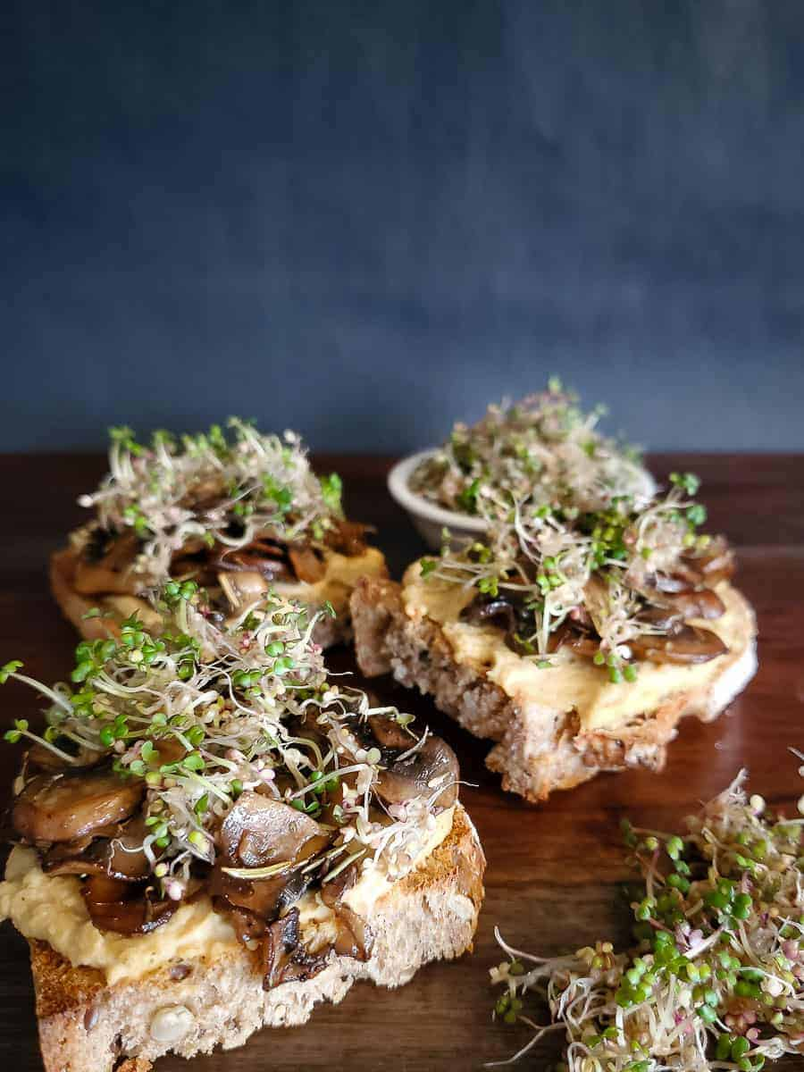 Toast With Mushrooms, Hummus, And Sprouts