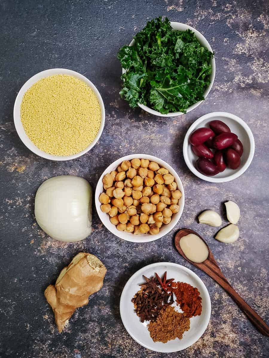 Couscous, Kale, Olives, Onion, Garlic, Chickpeas, Spices, And Tahini