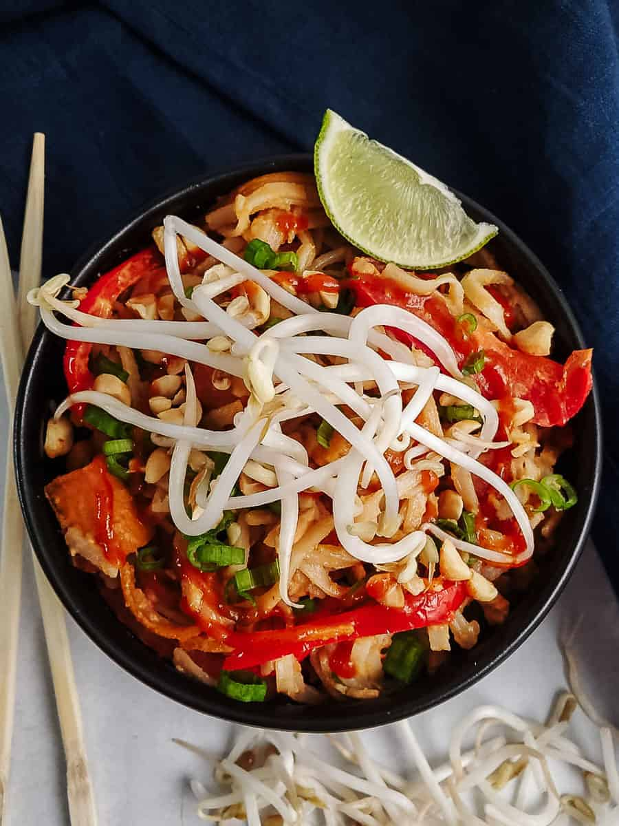 Spicy Peanut Noodles With Tofu In A Bowl