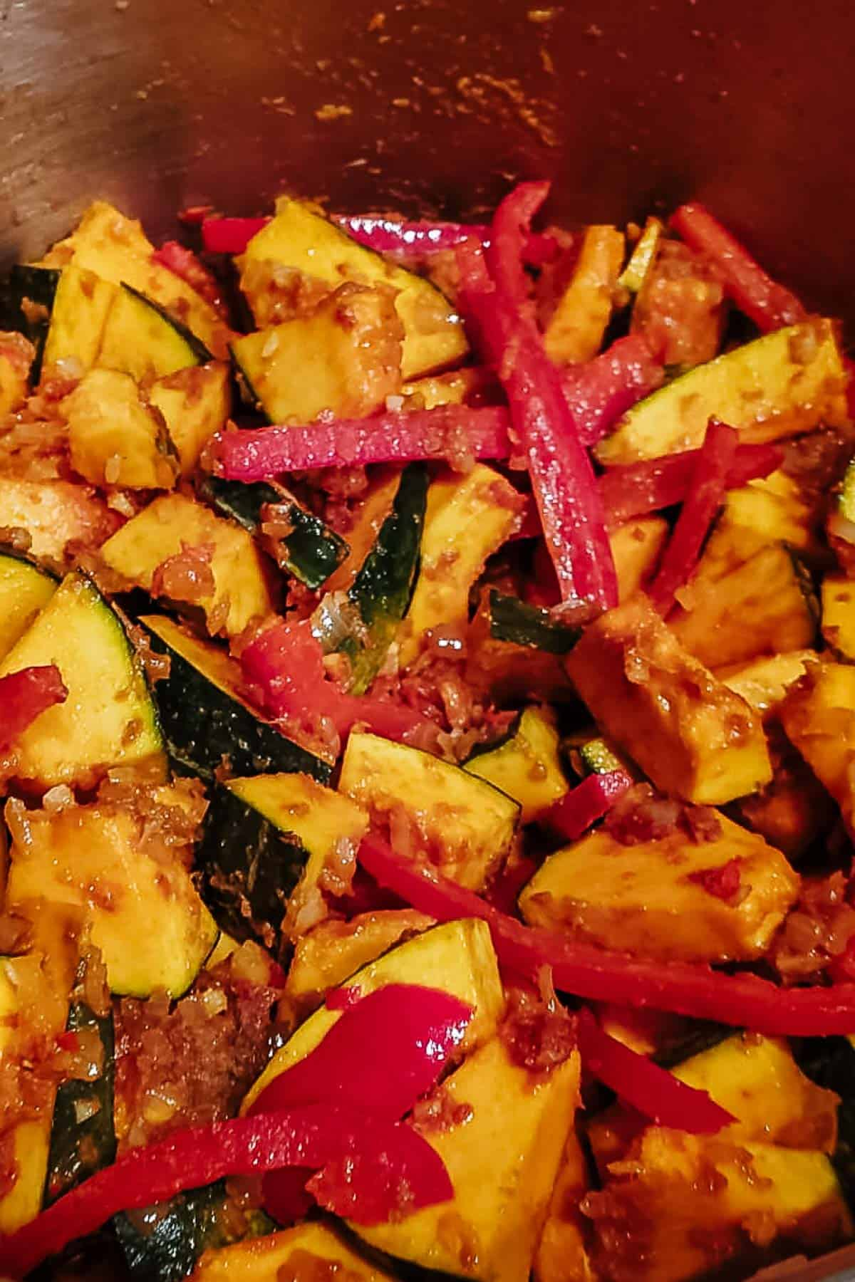 Kabocha Squash, Peppers, & Seasonings In A Pot