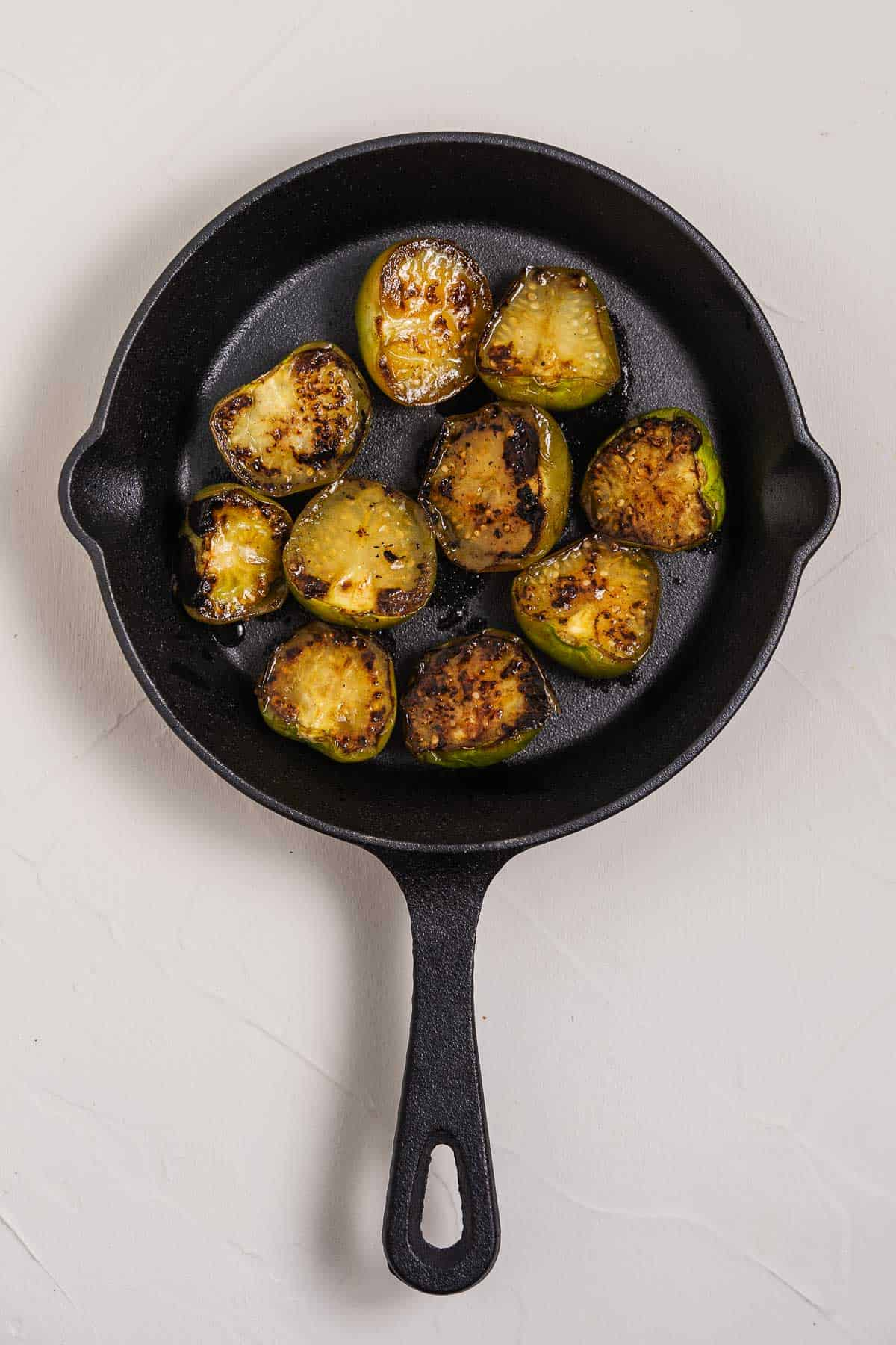 Charred Tomatillos in a Cast Iron Pan
