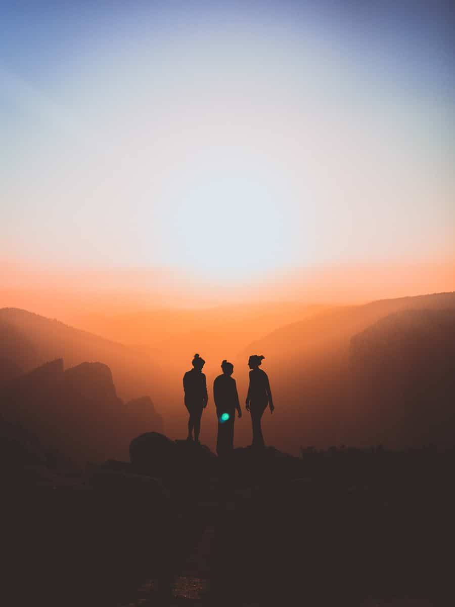 People Standing on a Mountain
