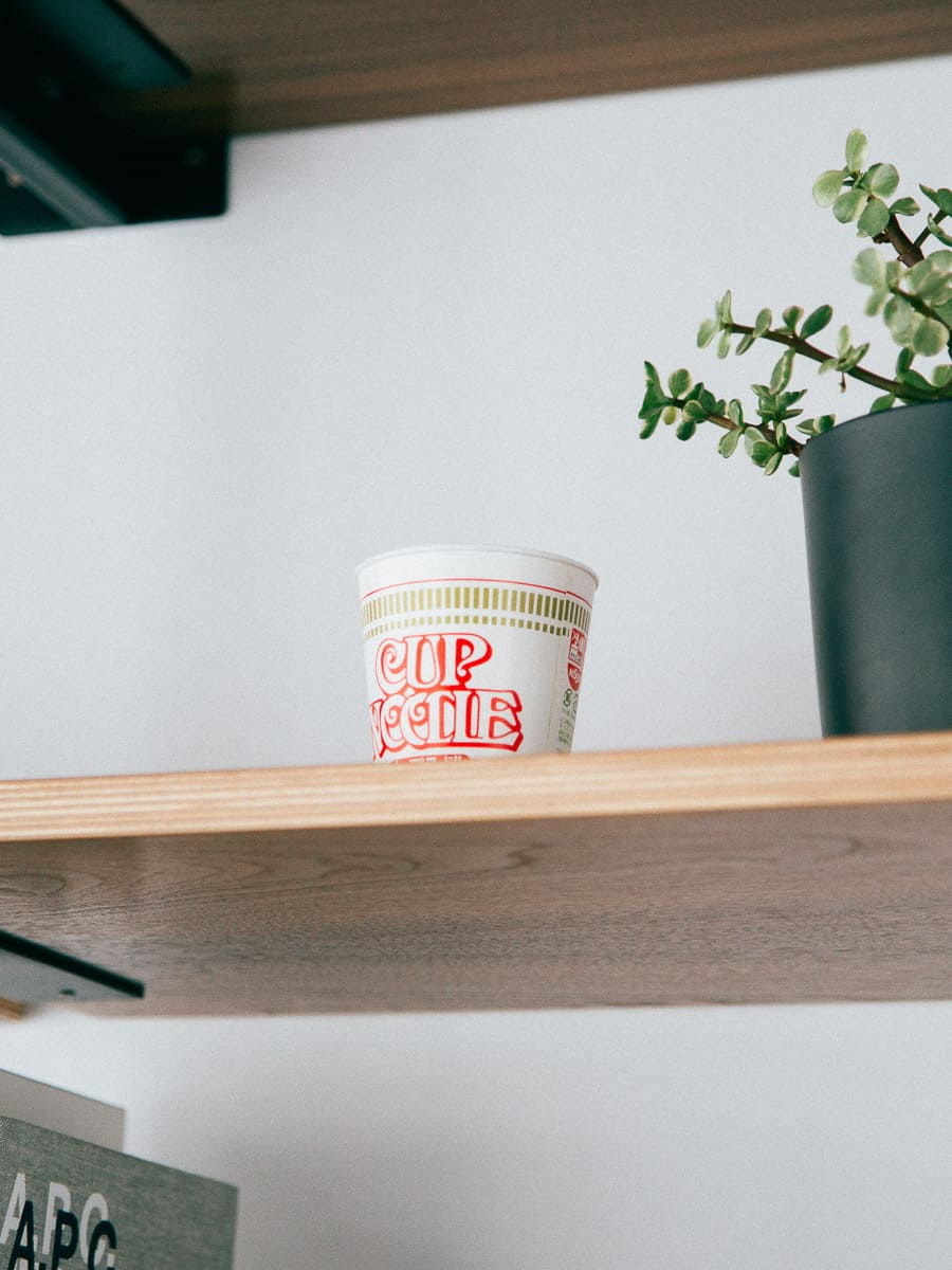 Cup of Noodles on a Shelf
