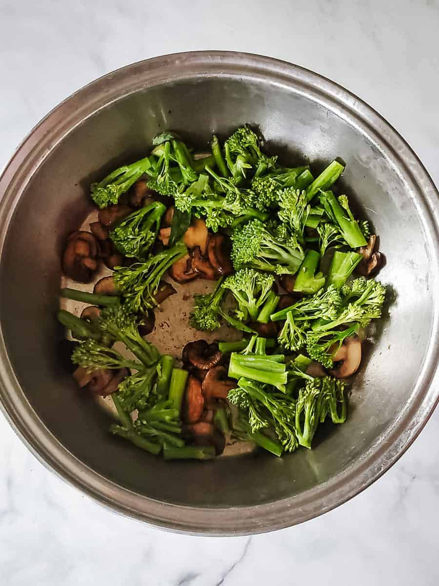 Mushrooms and Broccolini In A Pan With Oil
