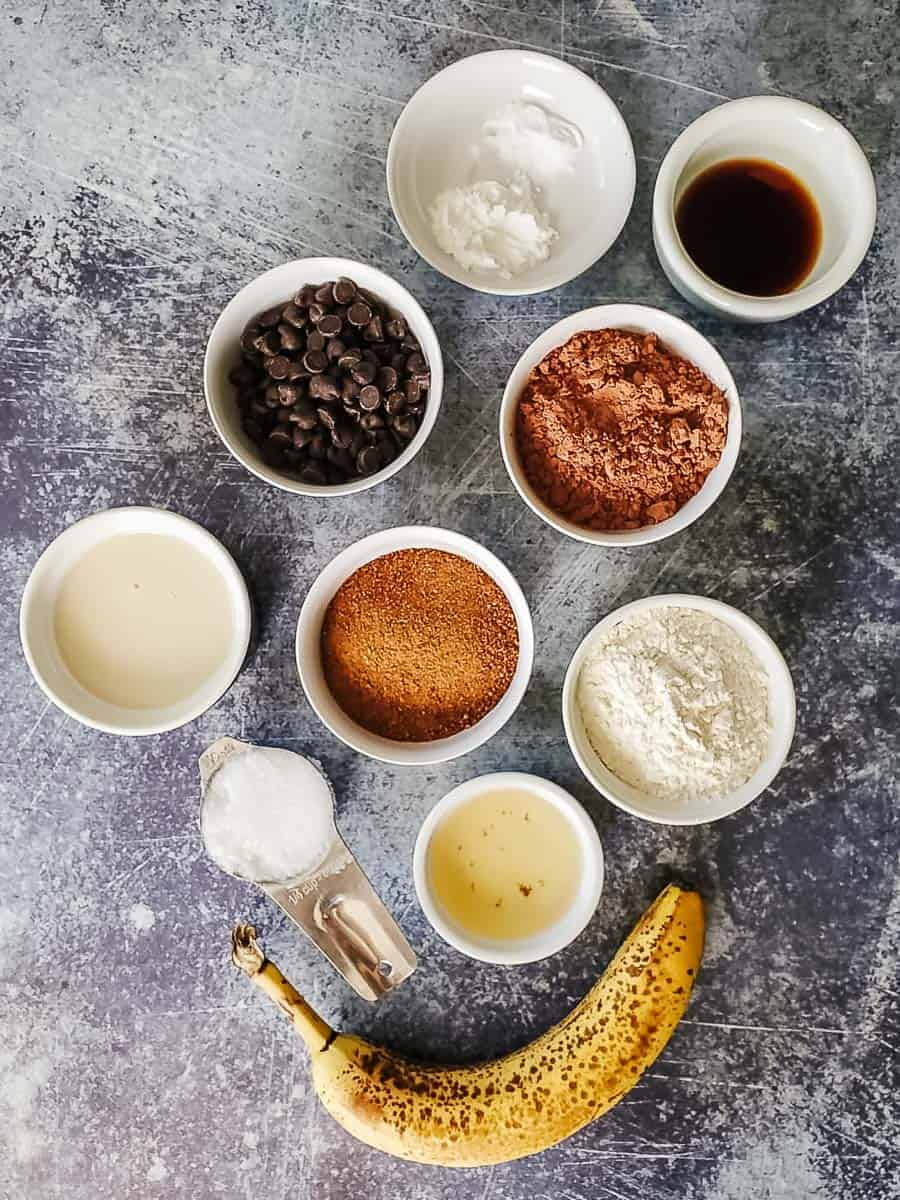 Banana, Apple Cider Vinegar, Cacao, Milk, Chocolate Chips, Coconut Oil, Vanilla, Sugar, And Flour
