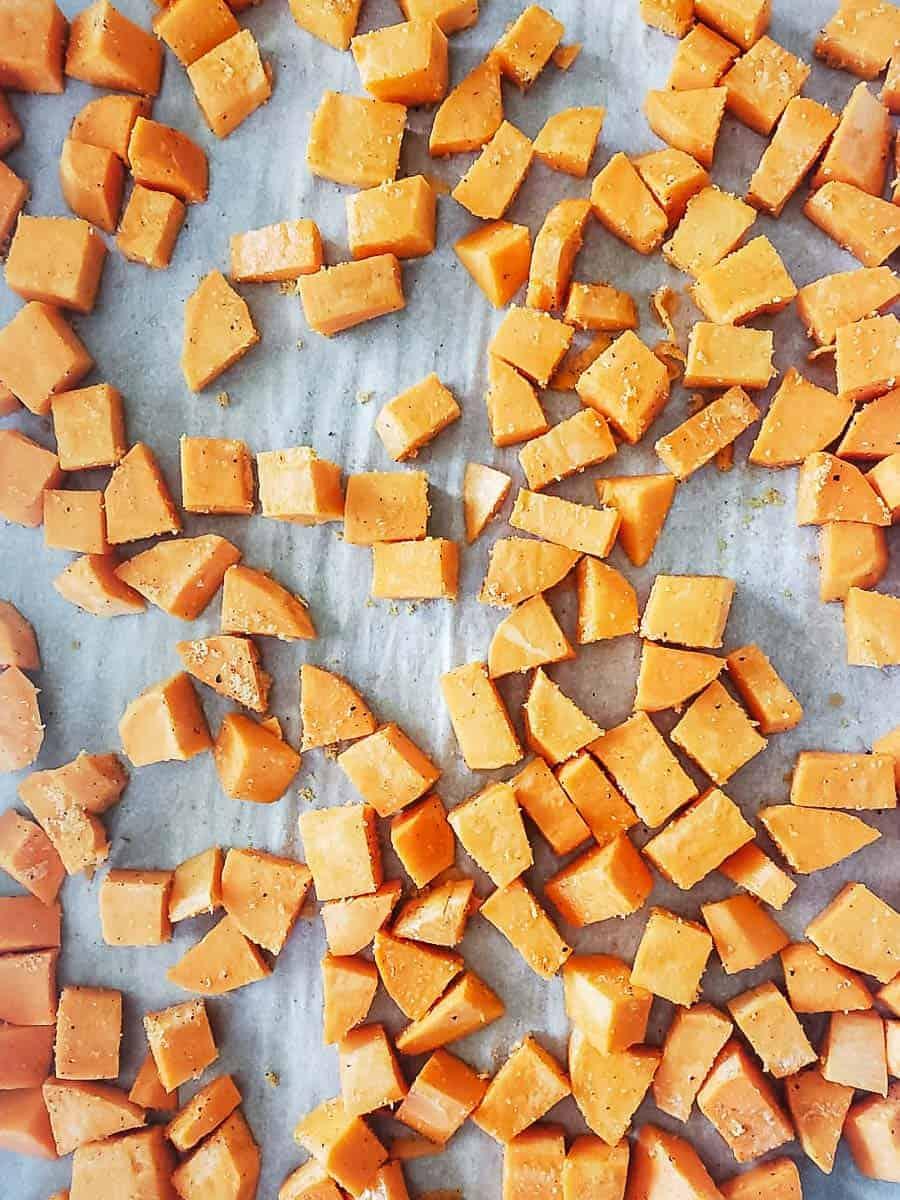Cubed Sweet Potatoes On A Baking Sheet