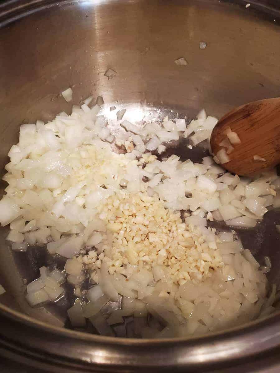 Onions & Garlic Sautéing In A Pan