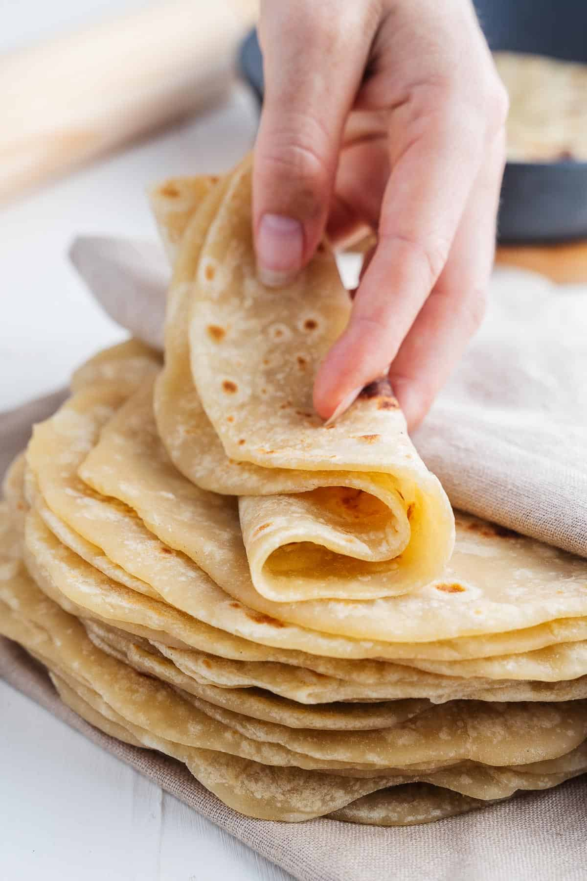 Folded Flour Tortilla in a Hand