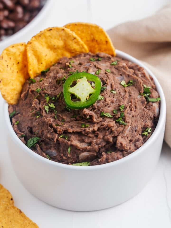 Refried Beans with Corn Chips in a Bowl