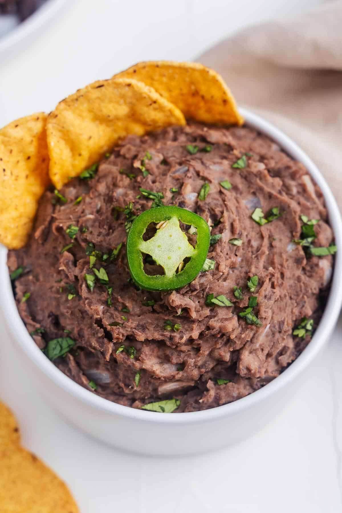 Refried Beans With Tortilla Chips in a Bowl