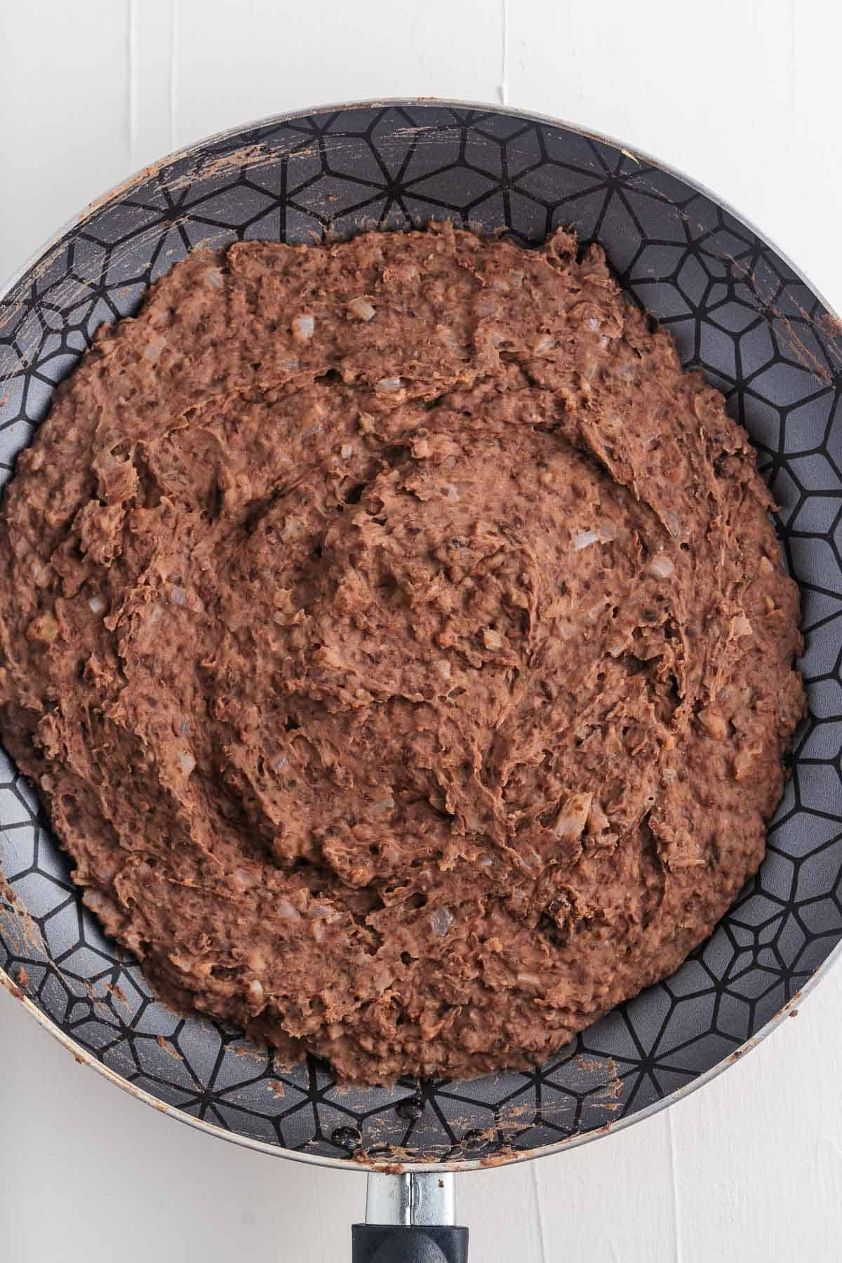 Refried beans in a frying pan