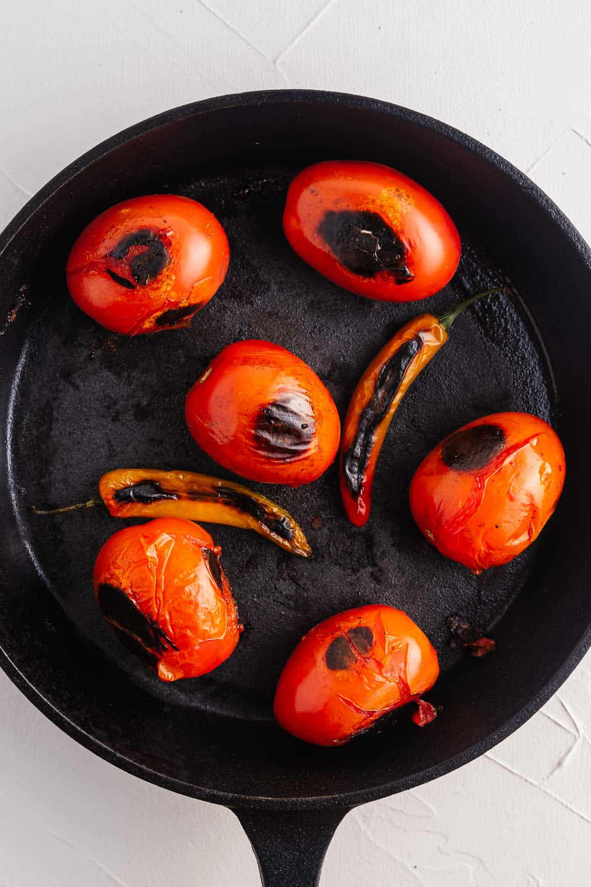 Blackened Tomatoes and Chilies in a Pan