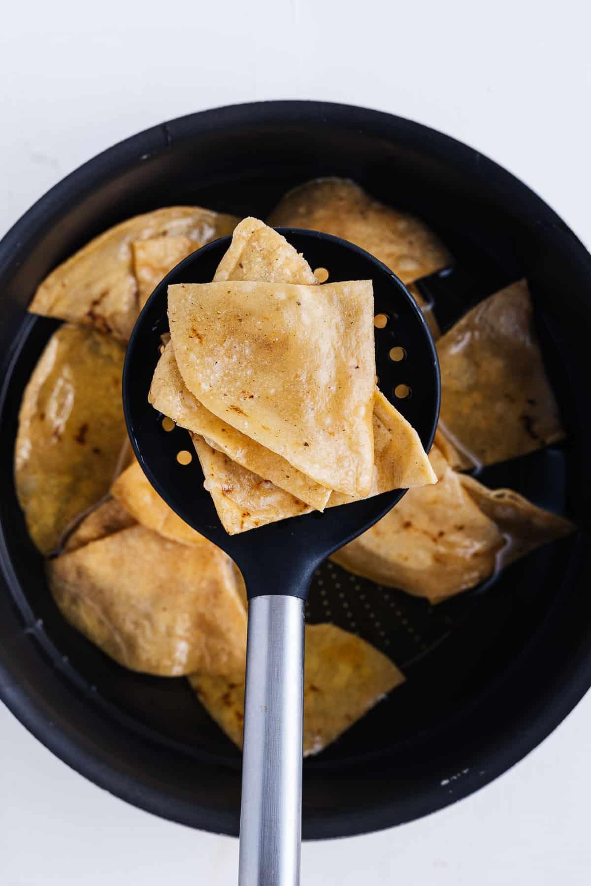 Fried Corn Tortillas in a Pot of Oil