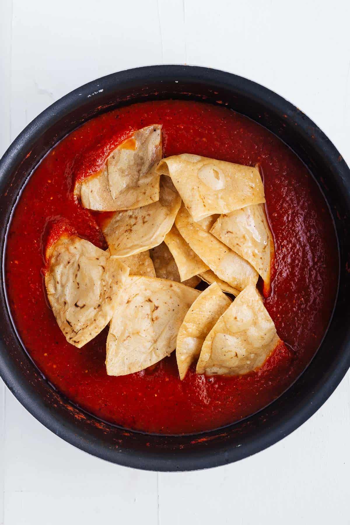 Tortilla Chips in a Pot of Salsa Roja