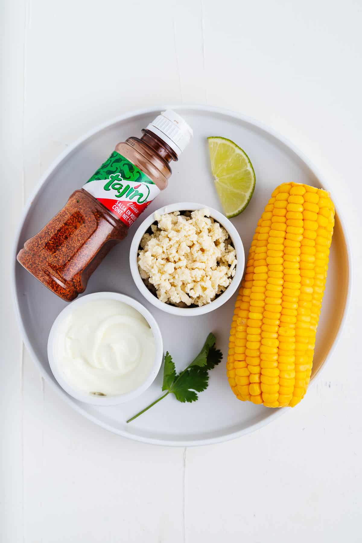 Tajin, Corn, Cotija, Vegan Mayo, Lime, and Cilantro