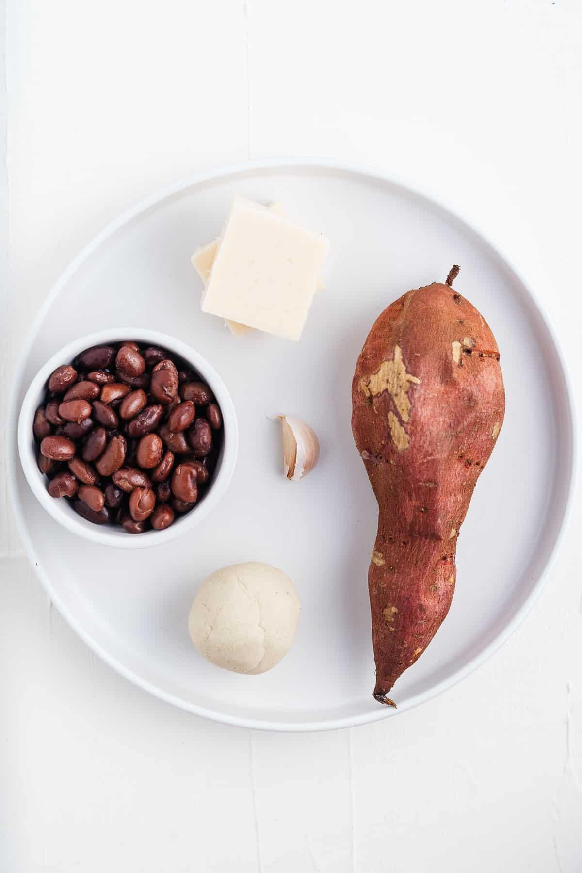 Sweet Potato, Vegan Cheese, Masa, Garlic, and Black Beans