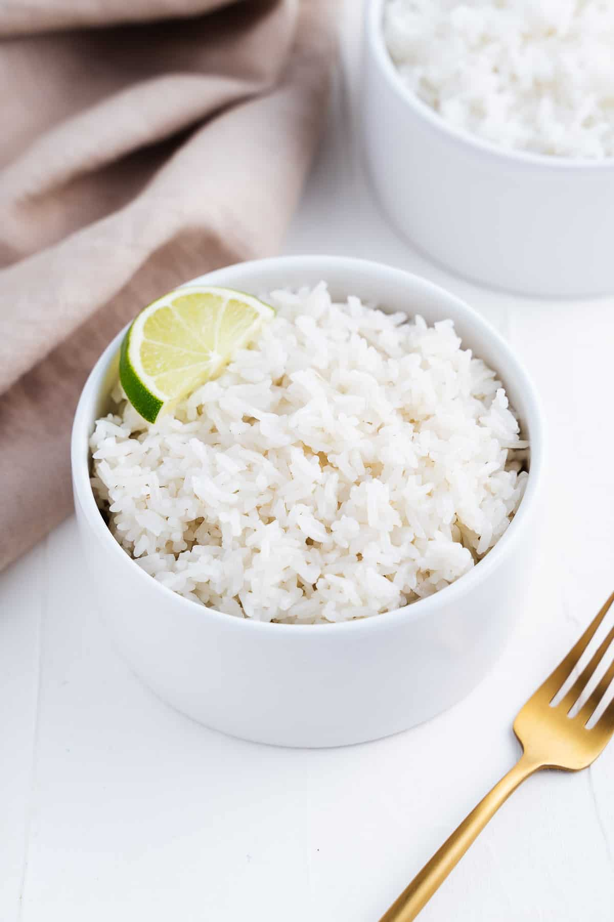 Bowl of White Rice With a Lime Wedge