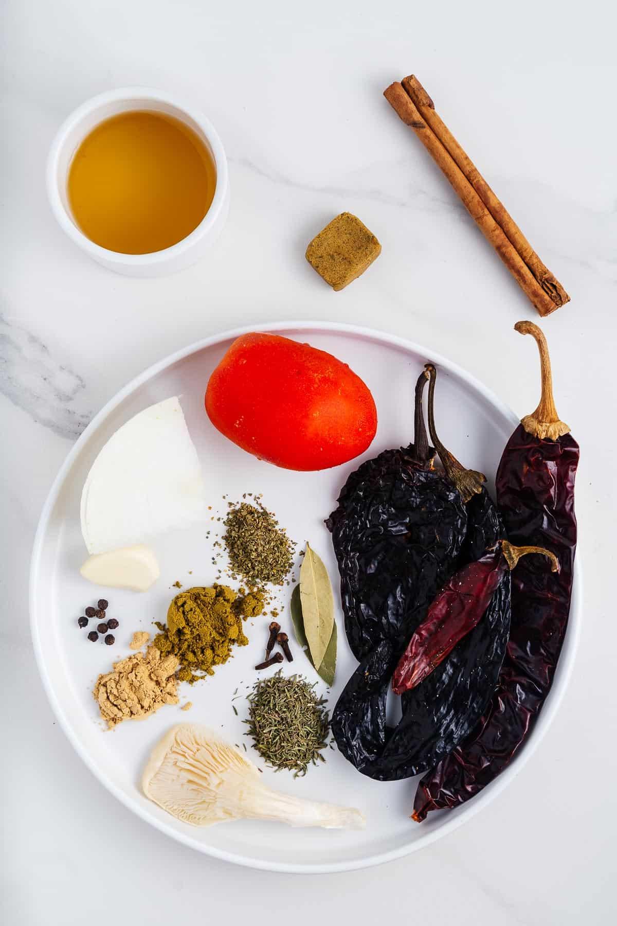 Tomato, Dried Chiles, Apple Cider Vinegar, Cinnamon Stick, Vegetable Bouillon, Spices, Herbs, Garlic, Mushroom, and Onion