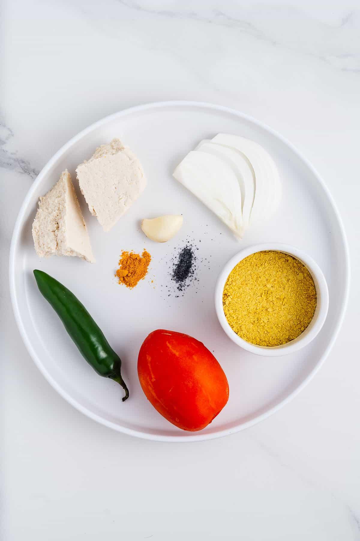Serrano, Tomatoes, Nutritional Yeast, Onion, Tofu, Garlic, Turmeric, and Salt