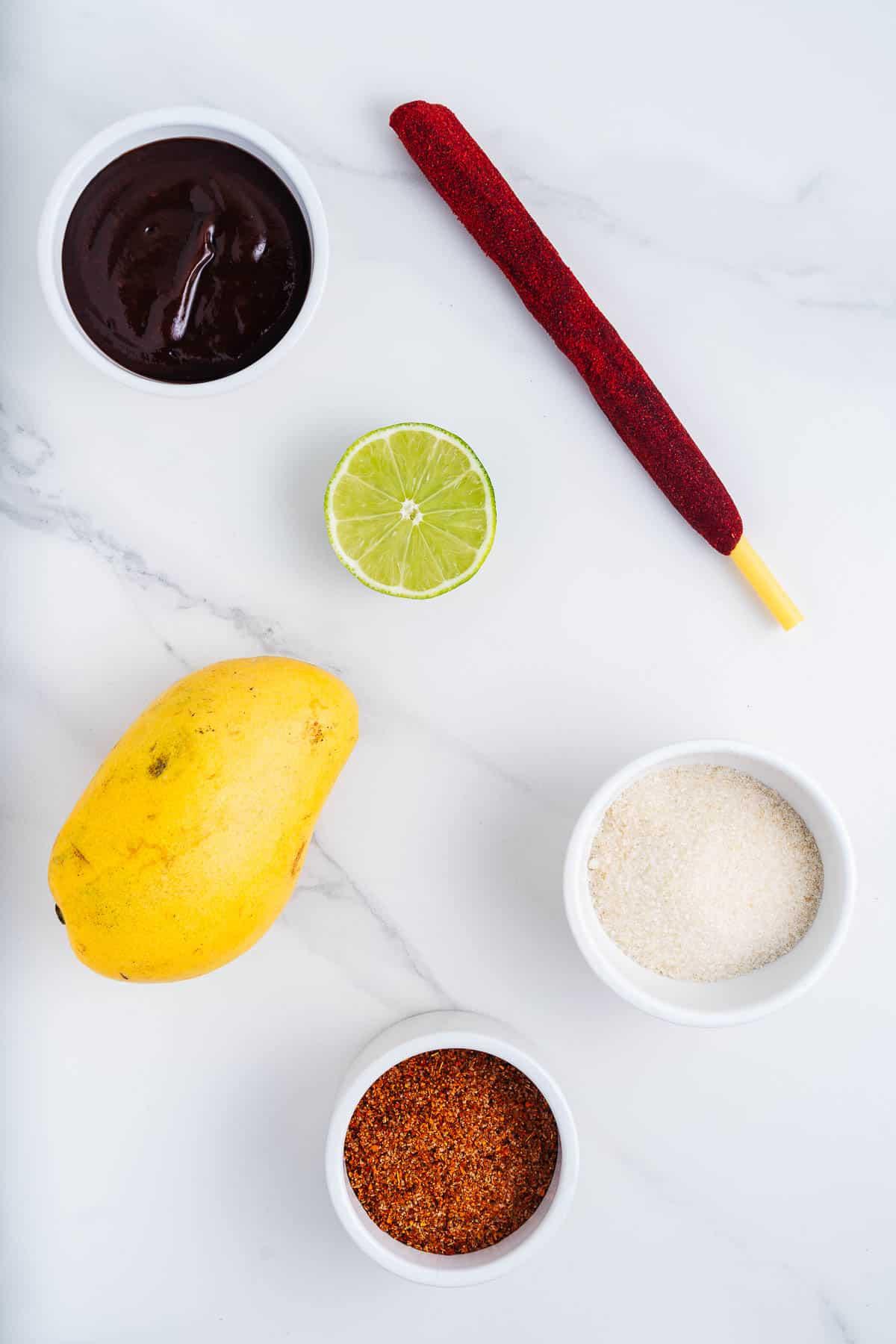 Tamarind Straw, Chamoy, Mango, Lime, Sugar, and Tajin