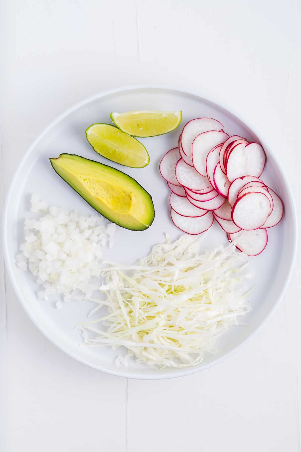 Avocado, Cabbage, Radishes, Limes, and Diced Onion