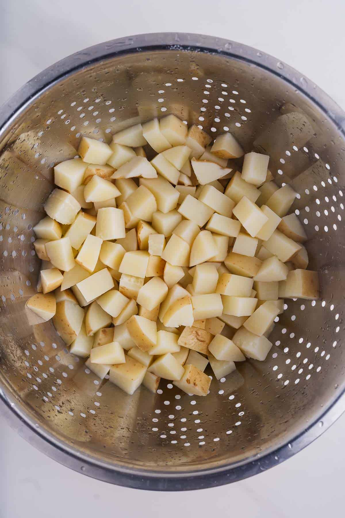 Potato Cubes in a Strainer