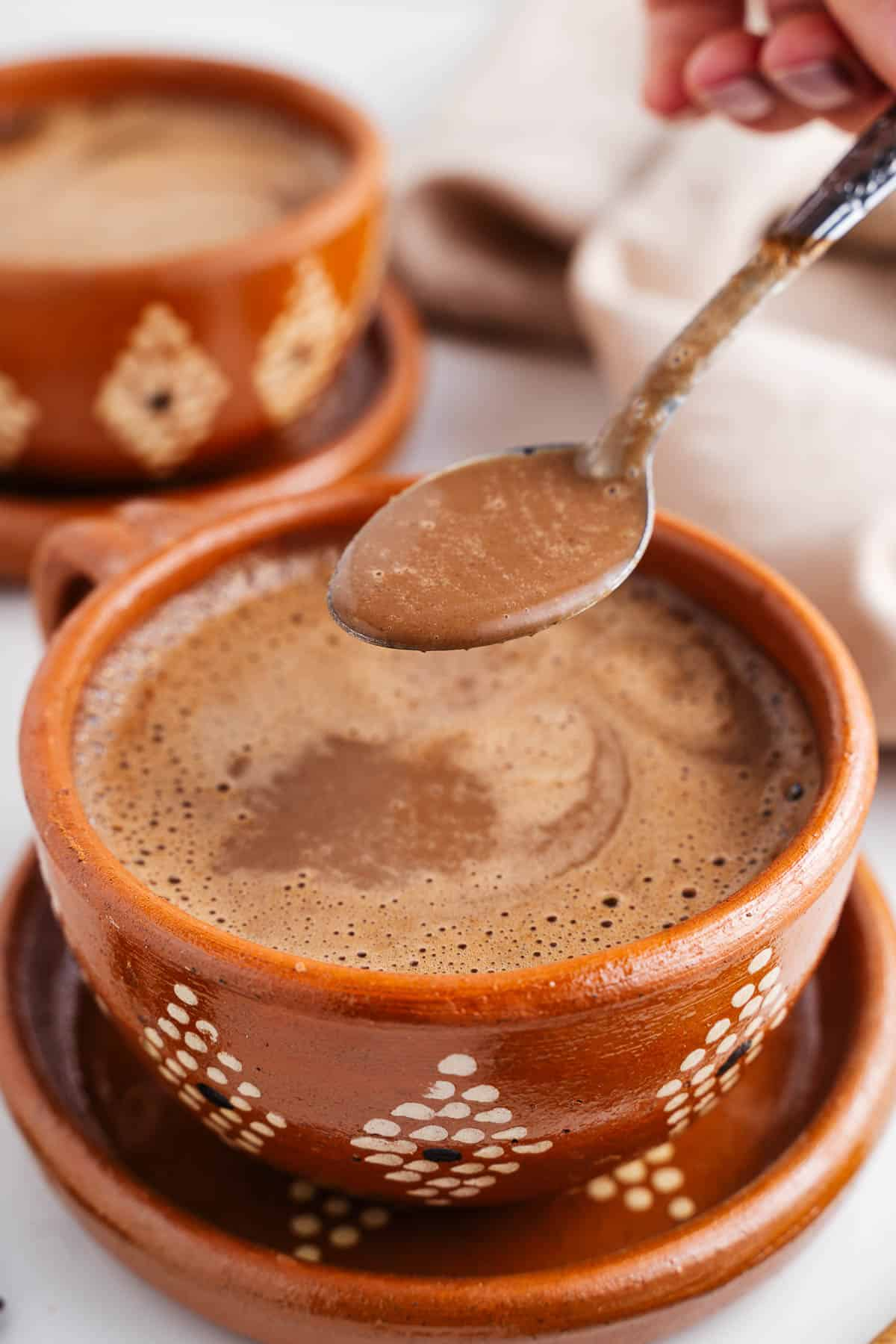 Champurrado on a Spoon Over a Cup