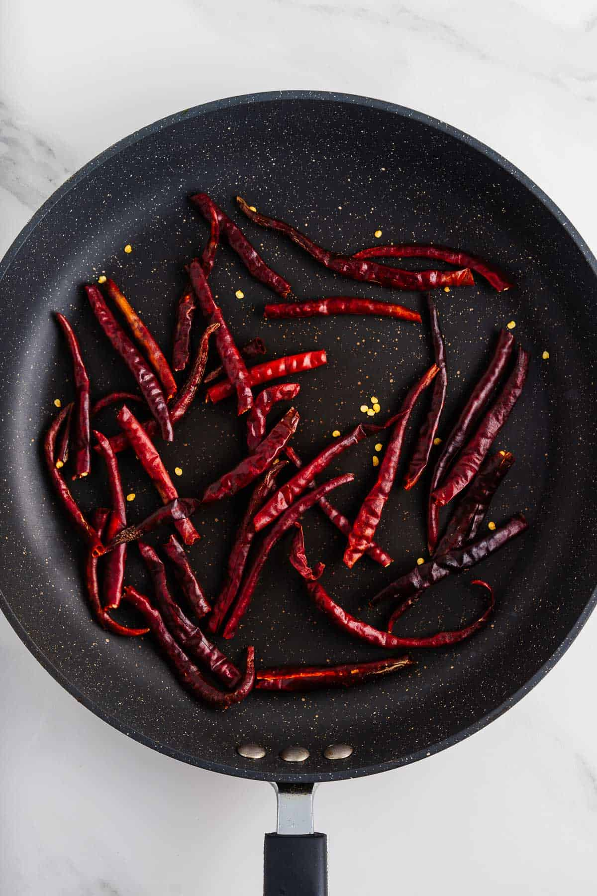 Toasted Chiles de Árbol in a Skillet