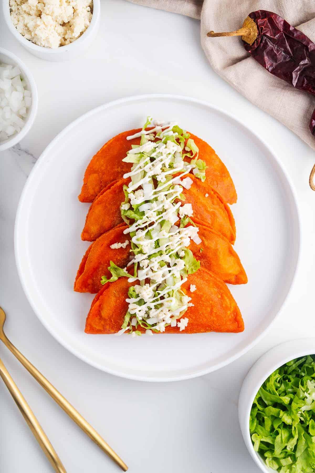 Enchiladas Potosinas on a Plate With Garnishes
