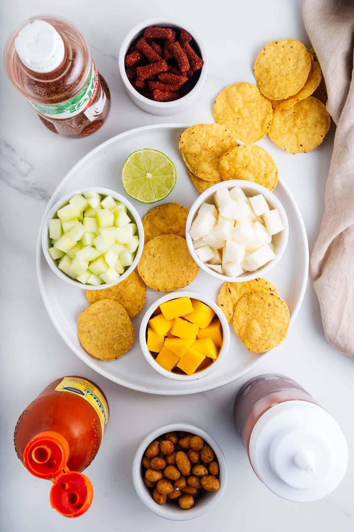 Tortilla Chips, Valentina, Japones, Chamoy, Jicama, Cucumber, Mango, Rielitos, and Tajin