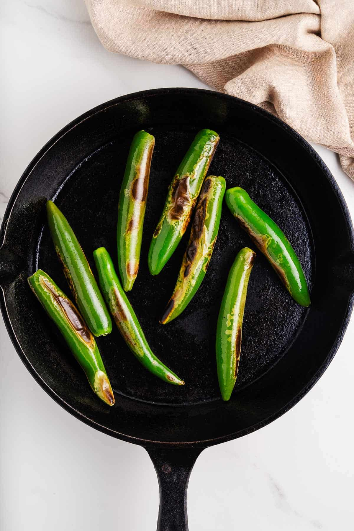 Blistered Serrano Chiles in a Skillet