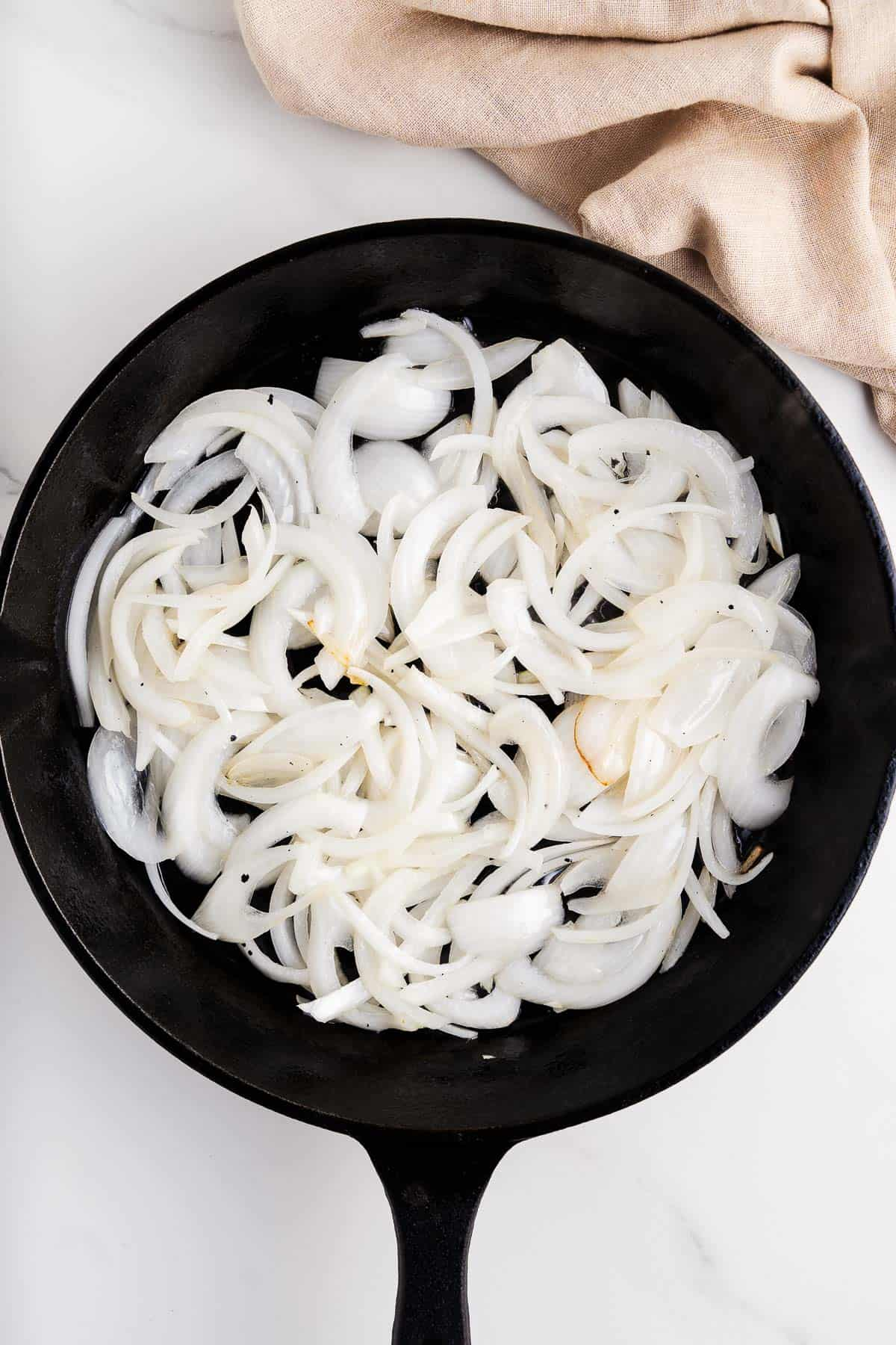 Sautéed White Onions in a Skillet