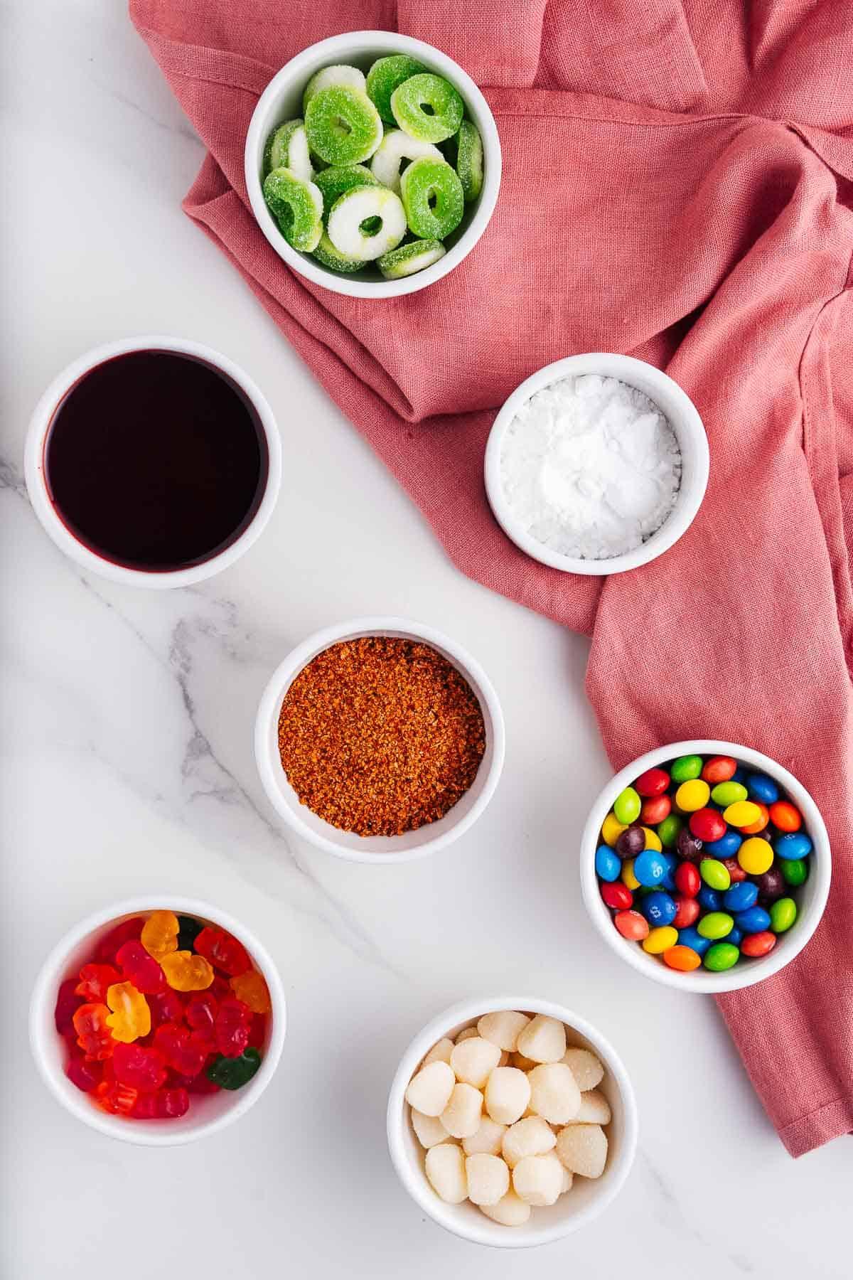 Candy, Tajin, Powdered Sugar, and Chamoy in Bowls