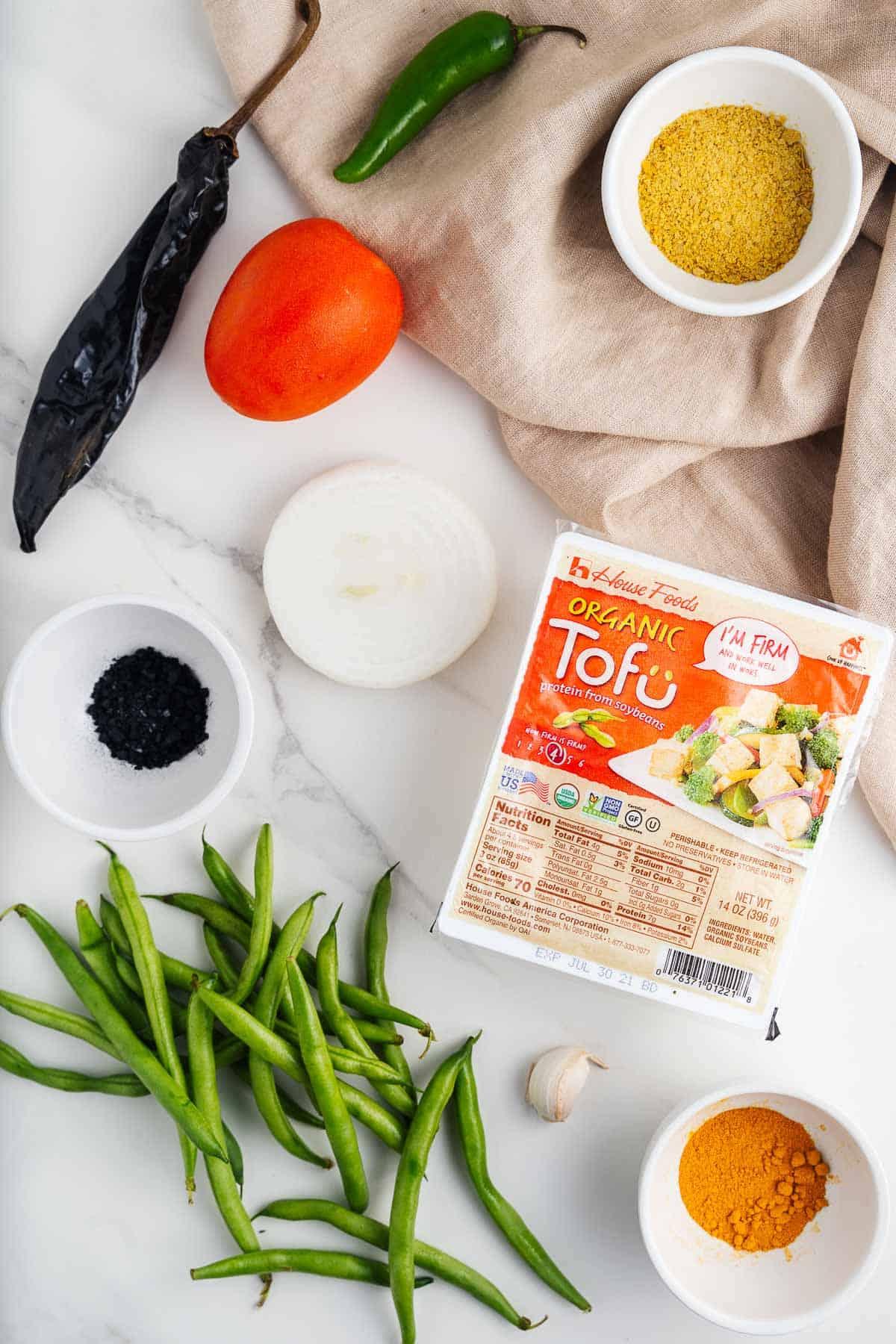Tofu, Green Beans, Tomato, Chiles, Garlic, Onion, Black Salt, Nutritional Yeast, and Turmeric