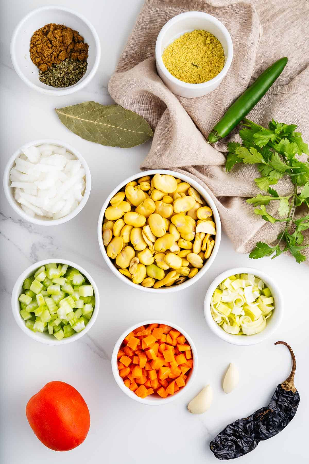 Fava Beans, Vegetables, Bay Leaves, Vegetable Stock, Spices, and Herbs