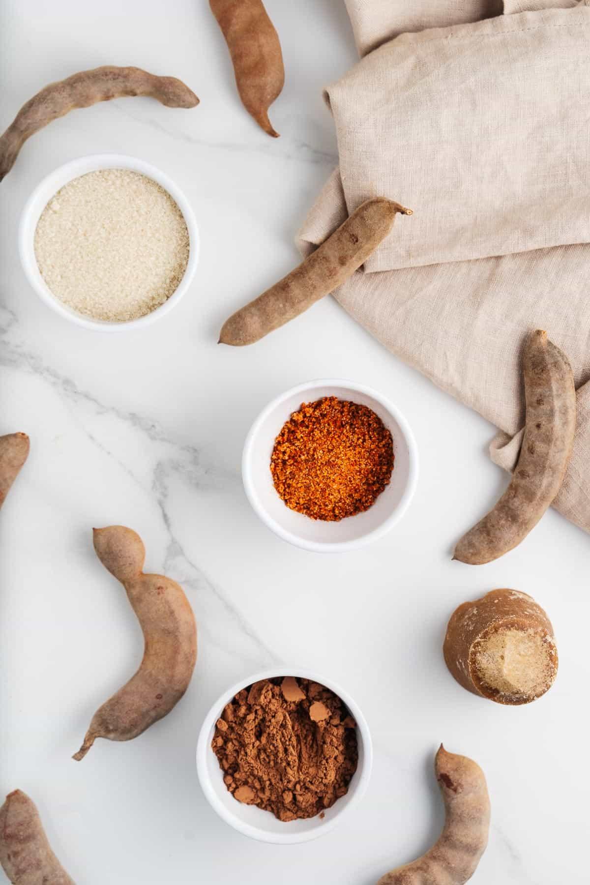 Tamarind Pods, Piloncillo, Cane Sugar, Cacao Powder, and Tajin
