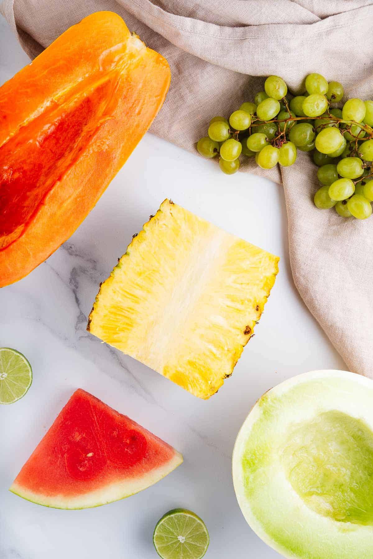Papaya, Pineapple, Watermelon, Limes, Honeydew, and Grapes